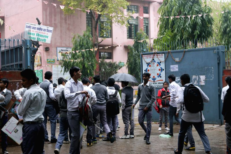 Students appearing for CBSE board exams arrive at their exam centre in New Delhi, on March 2, 2015.