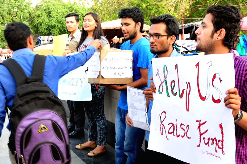 Students collect donations for the victims of Nepal earthquake in New Delhi, on April 27, 2015.