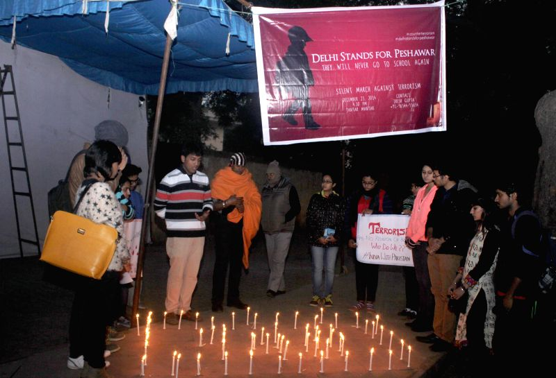 Students participate in a candlelight vigil to protest against the recent attack on Army Public School in Peshawar, Pakistan, that claimed 148 lives, mostly children, at Jantar Mantar in ..