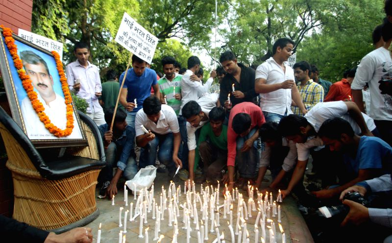 Students participate in a candlelight vigil organised to pay tribute to former Delhi legislator Bharat Singh, who was shot at on 29th March 2015; at  Jantar Mantar on April 29, 2015.