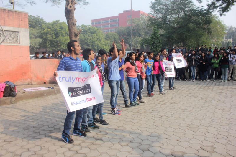 Students promote a dating app that was launched at the North campus of Delhi University in New Delhi on Jan. 6, 2014.