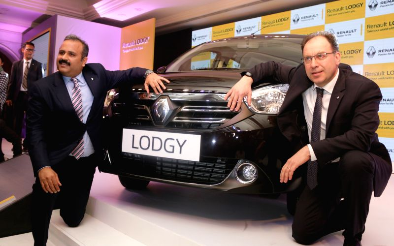 Sumit Sawhney, Country CEO and Managing Director with Rafael Treguer Vice President Sales & Marketing, Renault India during the launch of Renault Lodgy, a MPV in New Delhi on April 9, ...