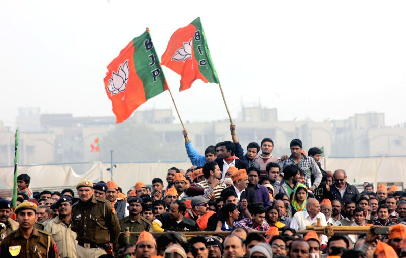 Supporters of Prime Minister Narendra Modi during a election rally in Rohini, New Delhi on Feb. 3, 2015. - Narendra Modi