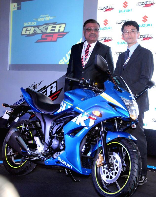 Suzuki Motorcycle India Executive Vice President Atul Gupta and GM (export) Kenji Hirojawa at the launch of the new Gixxer SF in New Delhi, on April 7, 2015. - Atul Gupta