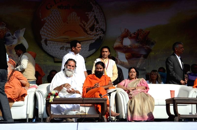 Swami Gyananand Sarswati with Baba Ramdev and External Affair Minister Sushma Swaraj during Geeta Prerna Utsav on  occasion of 5151 years of Shri Bhagwat Geeta at Red Fort ground in New ... - Sushma Swaraj