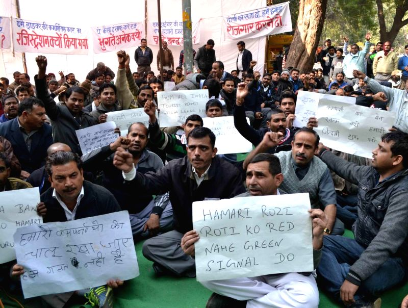 Taxi drivers of private taxi companies who have been asked to halt operations stage a demonstration to demand lifting of ban on their services in New Delhi, on Jan 16, 2015.