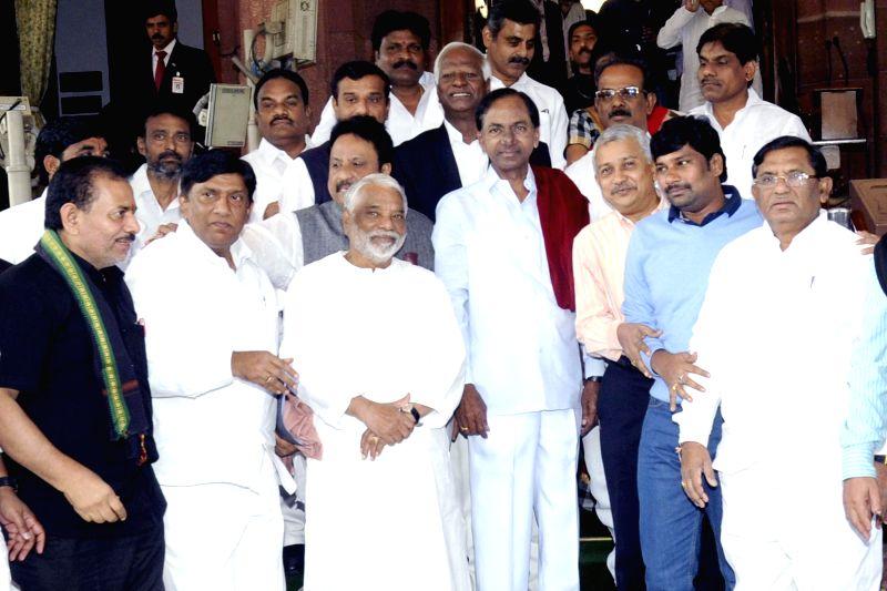 Telangana Chief Minister K Chandrasekhar Rao with K. Keshava Rao an other TRS MPs at the Parliament House in New Delhi, on Dec 8, 2014. - K Chandrasekhar Rao and K. Keshava Rao