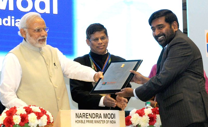 Telangana Energy Minister G Jagadish Reddy receives the National Award from Prime Minister Narendera Modi during RE-INVEST 2015 - India's first Renewable Energy Global Investor's Meet . - G Jagadish Reddy and Narendera Modi