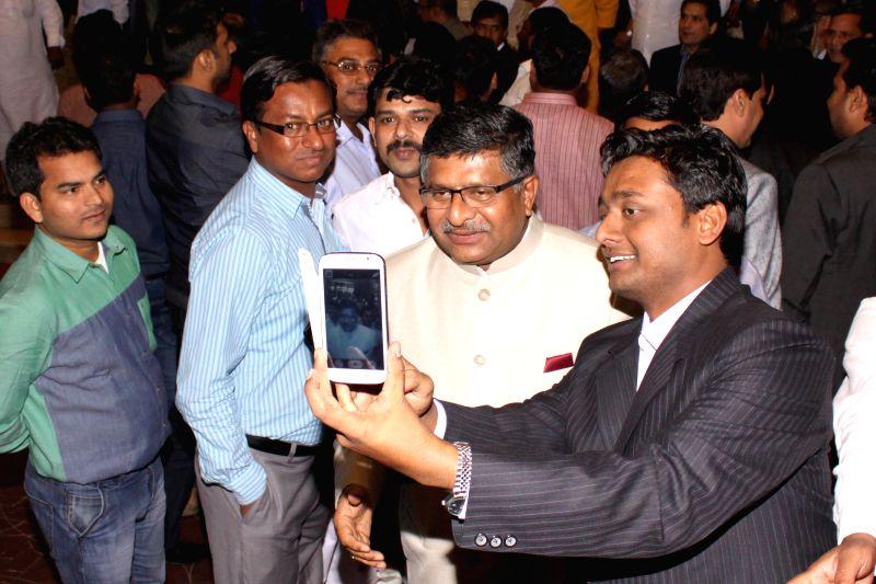Telecom minister Ravi Shankar Prasad during the  Wedding ceremony of Rashtriya Janata Dal chief Lalu Yadav's daughter Raj Lakshmi with Samajwadi Party supremo Mulayam Singh Yadav's ... - Ravi Shankar Prasad, Mulayam Singh Yadav and Tej Pratap Yadav
