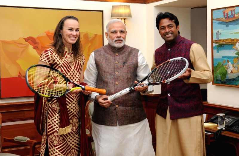 Tennis Players Martina Hingis and Leander Paes present autographed racquets which they used during the Aus Open Mixed Doubles Finals to Prime Minister Narendra Modi, in New Delhi on March ... - Narendra Modi