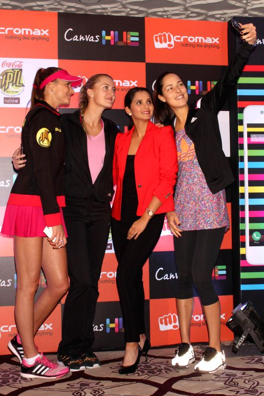 Tennis players Sania Mirza, Ana Ivanovic, Kristina Mladenovic and Daniela Hantuchova at the launch of the `Canvas Selfie` in New Delhi on Dec 8, 2014.