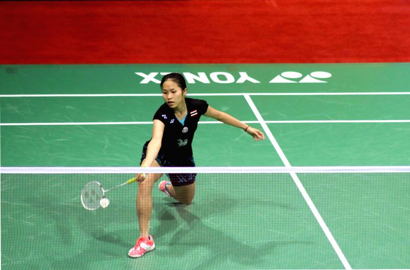 Thailand badminton player Ratchanok Intanon returns a shot to Carolina Marin of Spain during a women`s singles match of Yonex Sunrise Indian Open Badminton Championship in New Delhi on ...
