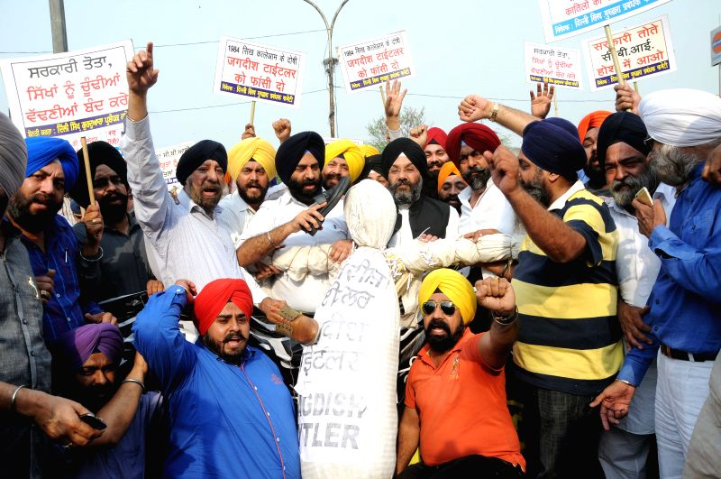 The activists Delhi Sikh Gurdwara Management Committee (DSGMC) and 1984 riot victims stage a demonstration outside the CBI headquarters against clean chit to Congress leader Jagdish ...