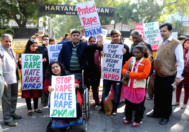 The activists of Delhi Viklang Adhikar Manch (DVAM), National Platform for the Rights of the Disabled (NPRD) and Janwadi Mahila Samiti shout slogans during a demonstration to protest ...