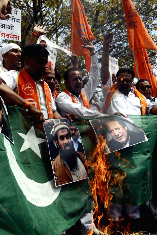 The activists of Shiv Sena burn Pakistani flags and posters of Pakistani Prime Minister Nawaz Sharif and suspected mastermind of the deadly Mumbai attacks in 2008 Zaki-ur-Rehman Lakhvi ... - Nawaz Sharif