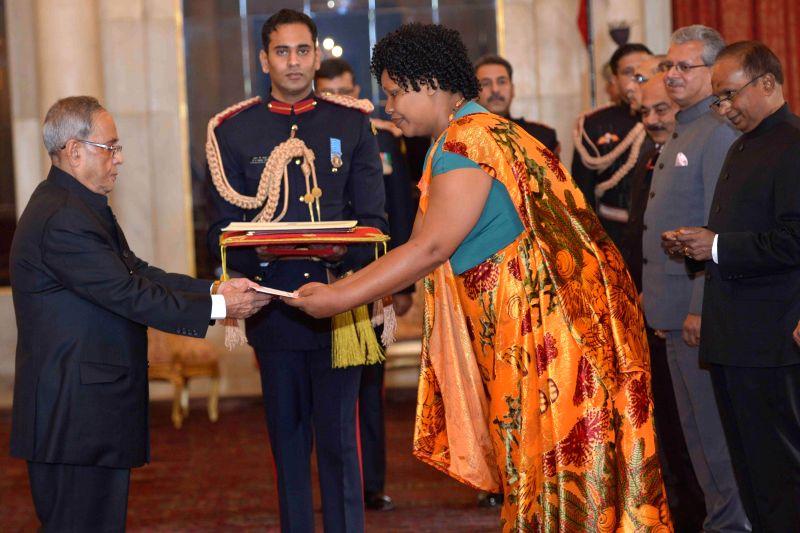 The Ambassador-designate of Burundi, Regine Katabarumwe presents her credential to the President Pranab Mukherjee at Rashtrapati Bhavan, in New Delhi on Jan 16, 2015. - Pranab Mukherjee