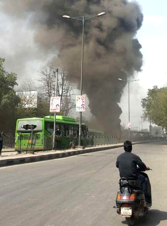 The buses that were damaged by an irate mob after a child was run over by a bus on Mehrauli Badarpur Road near Ambedkar Nagar, New Delhi on March 13, 2015.
