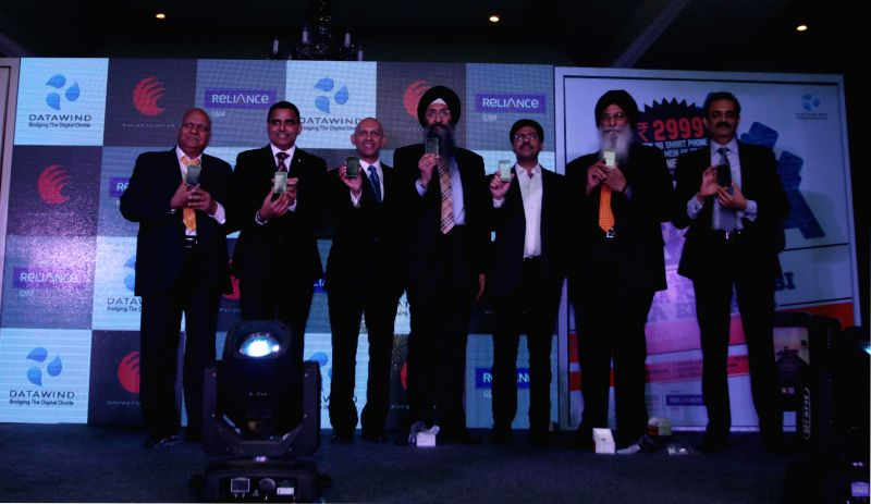 The CEO of Datawind Suneet Singh Tuli and others at the launch of a product in New Delhi, on March 17, 2015.