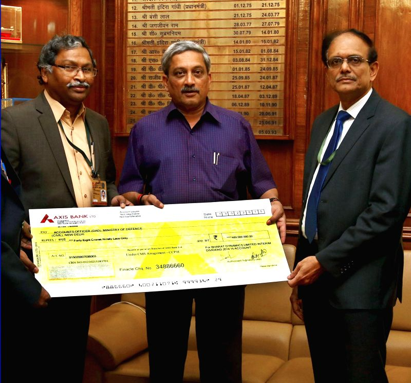 The Chairman and Managing Director, Bharat Dynamics Limited (BDL) V. Udaya Bhaskar presents an interim dividend cheque of Rs. 48.90 crore for the financial year 2014-15 to the Union ...