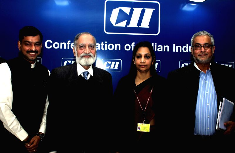 The Chairman of CII National Committee on Telecom and Broadband Kiran Karnik and others during a CII conference in New Delhi, on Dec 18, 2014.