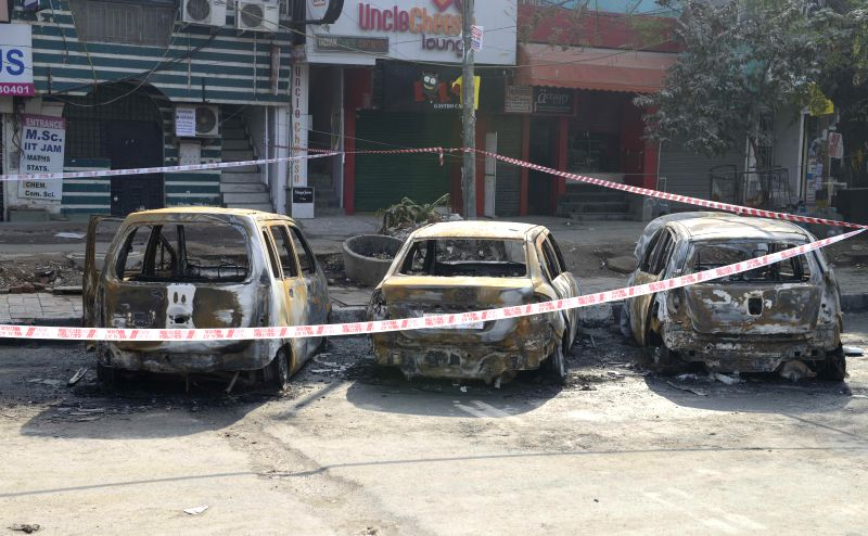 The charred remains of the vehicles that were gutted in a fire that broke out due to leakage in a gas pipeline in south Delhi's Satya Niketan area, near Sri Venkateswara College on Jan 16,