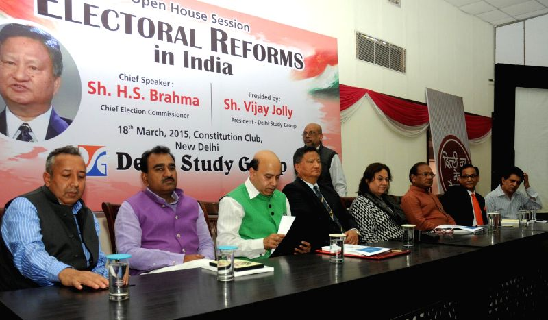 The Chief Election Commissioner H.S. Bramha and others participate in an Open House Session on the Electoral Reforms in India, in New Delhi on March 18, 2015.