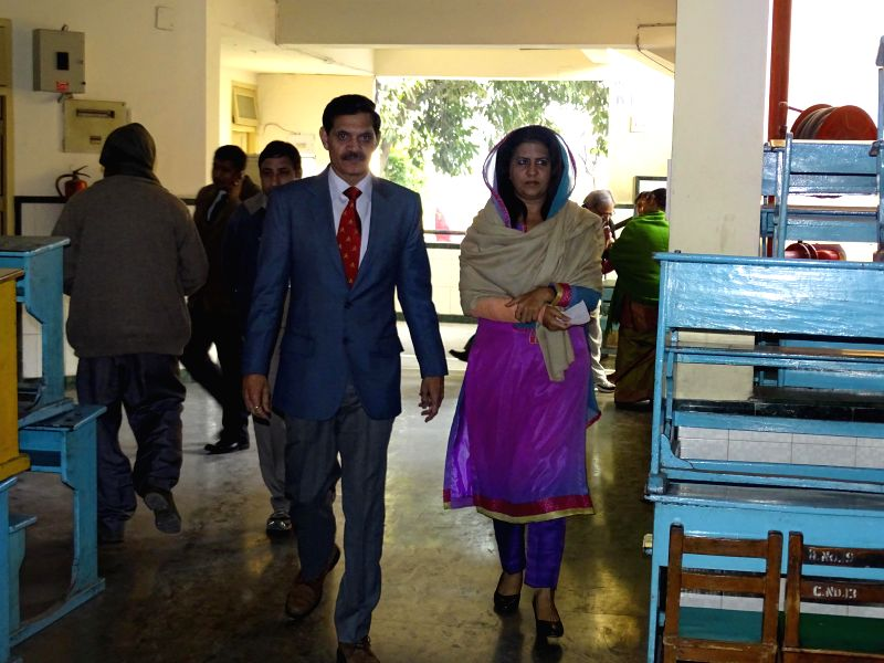 The Chief of Army Staff General Dalbir Singh and his wife Namita Suhag arrive to cast their votes at a polling booth during Delhi Assembly Polls in New Delhi, on Feb 7, 2015.