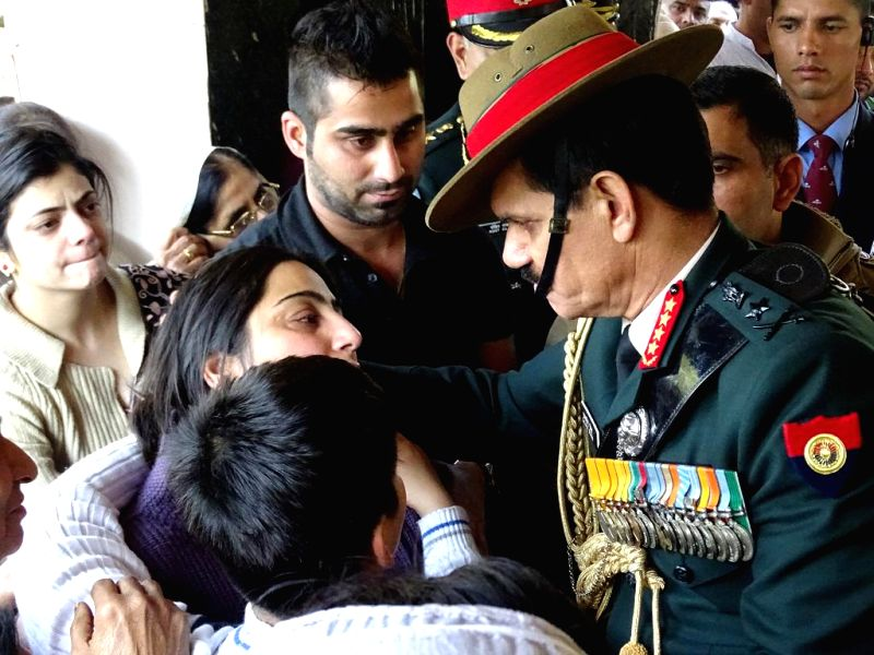 The Chief of Army Staff, General Dalbir Singh pays condolences to the family of Lt. Col Rajesh Gulati prior to his cremation, in New Delhi on Feb 13, 2015. Gulati was killed in an Advanced