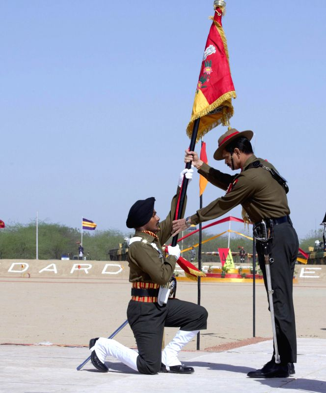 The Chief of Army Staff, General Dalbir Singh presents the President's 'Standards' to 44 Armoured Regiment, at Suratgarh Military Station, in Rajasthan on Feb 25, 2015.