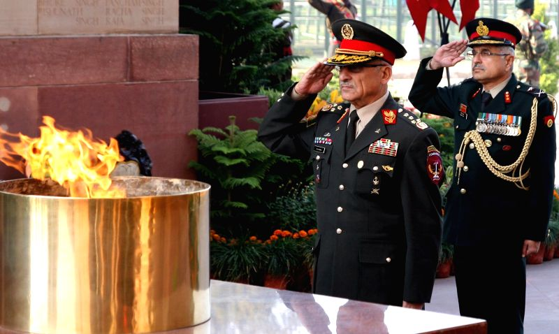 The Chief of General Staff, Afghan National Army, General Sher Mohammad Karimi pays homage, at Amar Jawan Jyoti, in New Delhi on Dec 11, 2014.