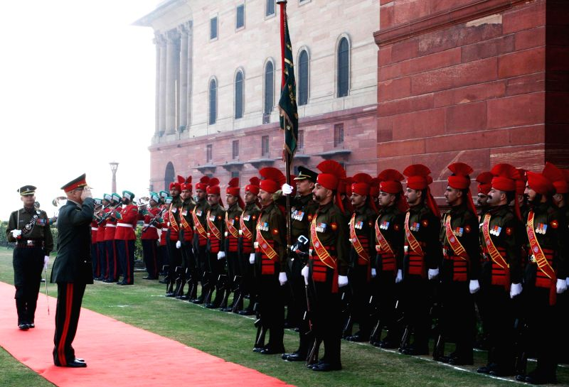 The Chief of General Staff, Afghan National Army, General Sher Mohammad Karimi inspects the Guard of Honour, in New Delhi on Dec 11, 2014.