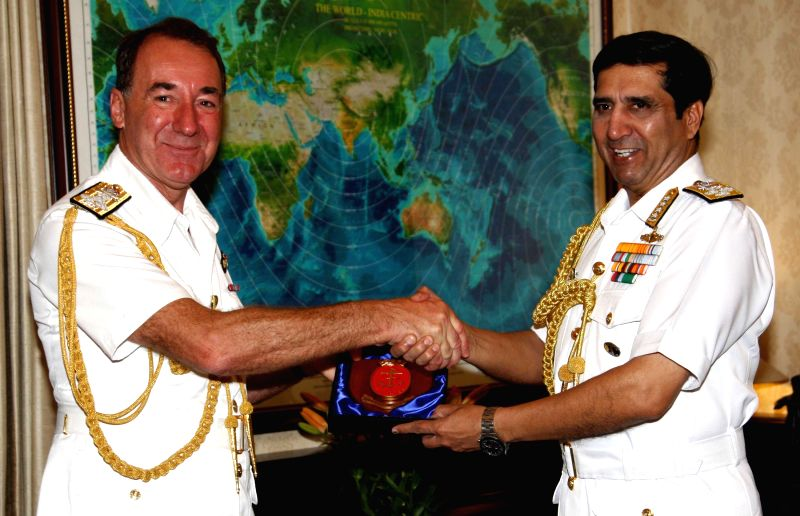 The Chief of Naval Staff, Admiral R.K. Dhowan exchanges memento with the First Sea Lord and CNS, Royal Navy, Admiral Sir George Zambellas, in New Delhi on March 16, 2015.