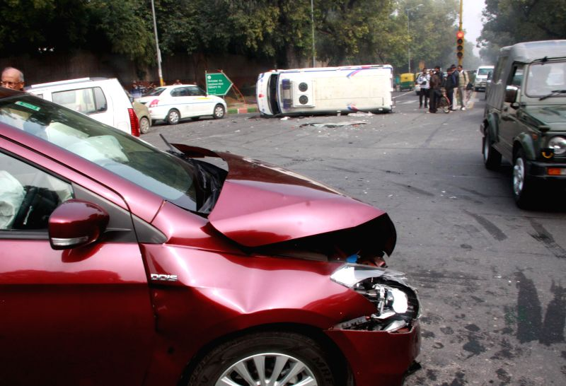 The damaged car that collided with an ambulance on Feroz Shah Kotla road in New Delhi, on Jan 12, 2015. - Feroz Shah Kotla