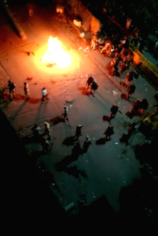 New Delhi: The Delhi Police resorted to mild lathi-charge and fired tear gas to disperse a crowd of Dalits, protesting against demolition of Saint Ravidas temple in south Delhi's Tughlaqabad area on Aug 22, 2019. (Photo: IANS)