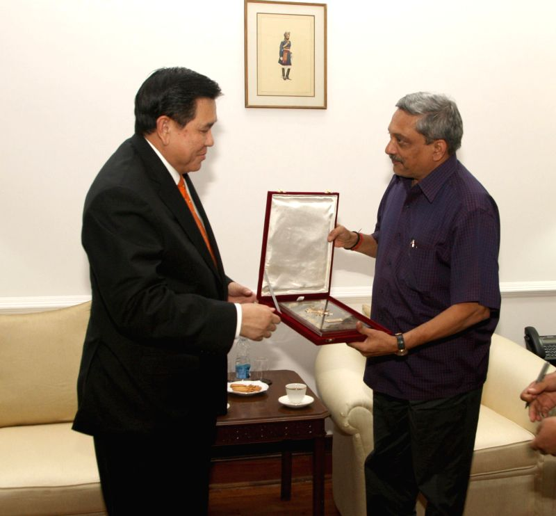 The Deputy Prime Minister and Foreign Affairs Minister of Thailand, General Tanasak Patimapragorn calls on the Union Minister for Defence, Manohar Parrikar, in New Delhi on March 11, 2015.