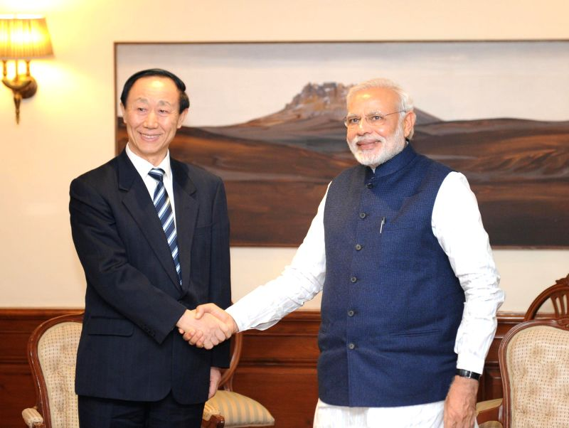 The Director of the International Department of the Central Committee of the Communist Party of China Wang Jiarui calls on Prime Minister Narendra Modi, in New Delhi on Feb 13, 2015. - Narendra Modi