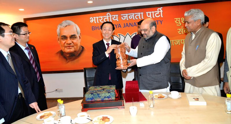 The Director of the International Department of the Central Committee of the Communist Party of China Wang Jiarui during a meeting with BJP chief Amit Shah in New Delhi, on Feb 15, 2015. - Amit Shah
