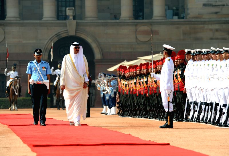 The Emir of the State of Qatar, His Highness Sheikh Tamim Bin Hamad Al-Thani inspects guard of honour during a ceremonial reception organised for him at Rashtrapati Bhavan, in New Delhi on ...