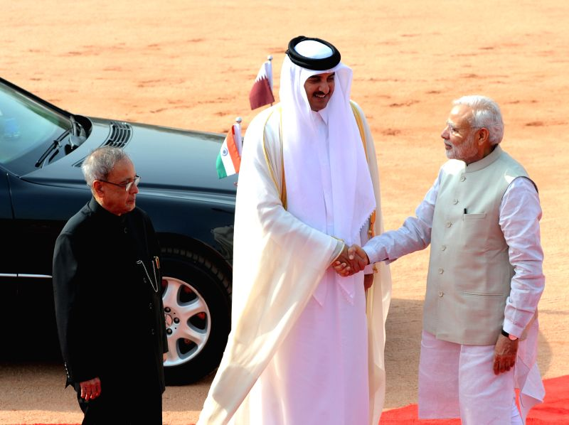 The Emir of the State of Qatar, His Highness Sheikh Tamim Bin Hamad Al-Thani being welcomed by President Pranab Mukherjee and Prime Minister Narendra Modi at the Ceremonial Reception ... - Narendra Modi and Pranab Mukherjee