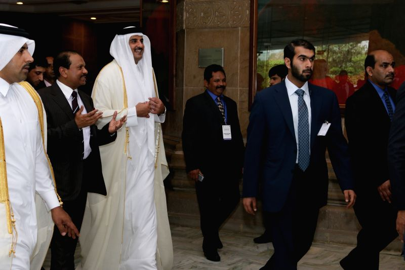 The Emir of the State of Qatar, His Highness Sheikh Tamim Bin Hamad Al-Thani arrives to attend the Qatar-Indian Economic Forum in New Delhi, on March 25, 2015.