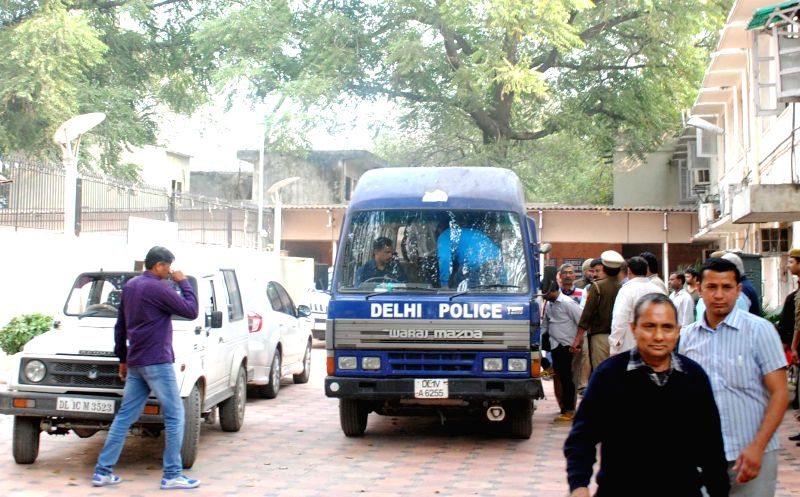 The five people arrested by the Delhi Police for stealing documents and leaking them to corporate houses being taken to be produced before a Delhi Court on Feb 20, 2015. The arrested ...