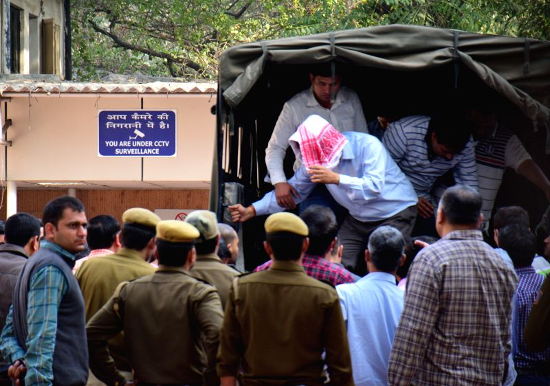 The five people arrested by the Delhi Police for stealing documents and leaking them to corporate houses being taken to be produced before a Metropolitan Megistrate`s court in New Delhi, ...