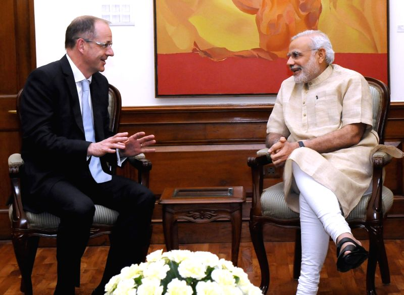 The Global CEO of GlaxoSmithKline Consumer Healthcare, Sir Andre Witty calls on Prime Minister Narendra Modi, in New Delhi on April 24, 2015. - Narendra Modi