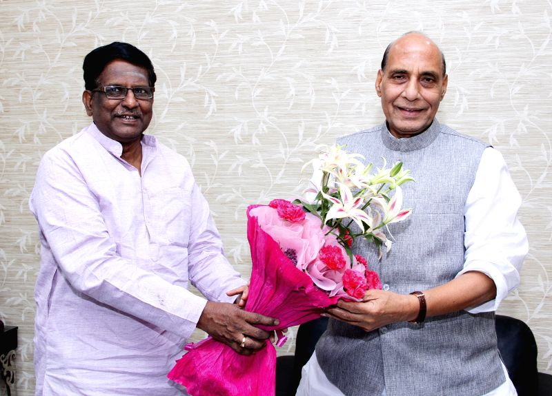 The Governor-designate of Meghalaya V. Shanmuganathan calls on Union Home Minister Rajnath Singh, in New Delhi on May 13, 2015.