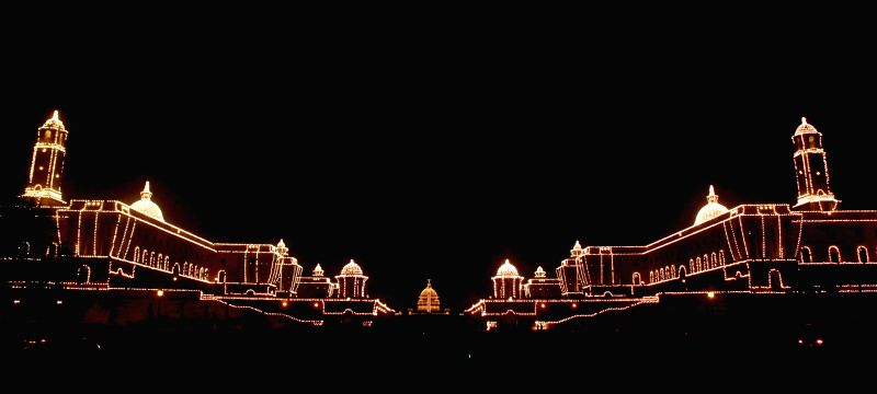 The illuminated Rashtrapati Bhavan with South and North Block during the Full-Dress rehearsal of Beating the Retreat ceremony at Raisina Hill in New Delhi on Jan. 27, 2014.