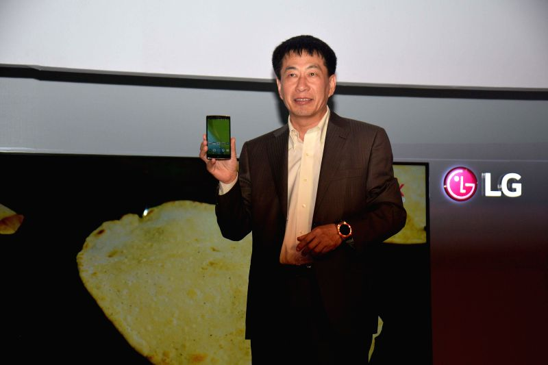 The Managing Director LG Electronics India Soon Kwon launches G Flex-2 - a curved Smartphone during a press conference in New Delhi, on March 18, 2015.