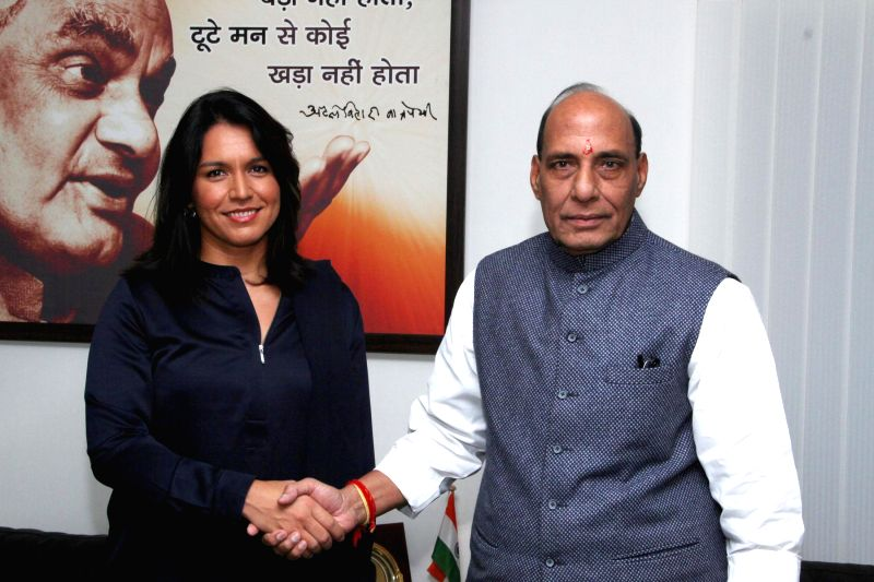 The Member of the US House of Representatives Tulsi Gabbard calls on the Union Home Minister Rajnath Singh, in New Delhi on Dec 18, 2014.