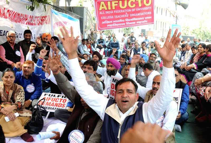 New Delhi:The members of All India Federation of University College Teachers Organisations (AIFUCTO) stage a demonstration outside UGC building to press for their demands in New Delhi, on Feb 19, ...