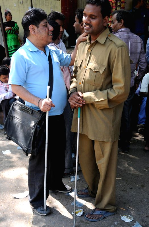 The members of Blind Workers' Union stage a demonstration to press for the removal of National Federation of the Blind (NFB) General Secretary Santosh Kumar Rungta in New Delhi, on April ...