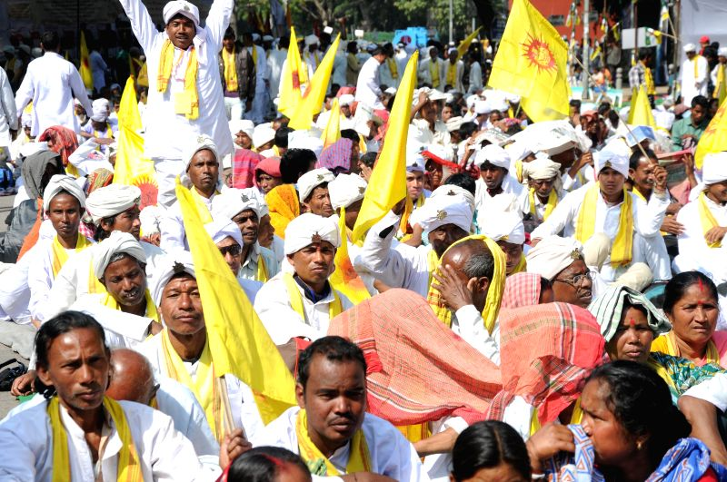The members of Greater Cooch Behar People's Association stage a demonstration near the Parliament to press for a separate state of  Cooch Behar in New Delhi, on March 10, 2015.